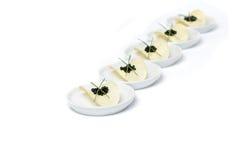 Black Caviar And Potato Chips Stock Photos