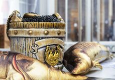 Black caviar in a barrel with a spoon royalty free stock photography