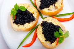 Black caviar  on bread Stock Image