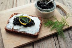 Black caviar on bread Royalty Free Stock Image