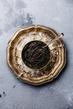 Black caviar in can on ice in metal plate Royalty Free Stock Photo