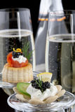 Black Caviar Canape and Champagne Stock Images