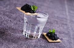 Black caviar on a cracker royalty free stock image