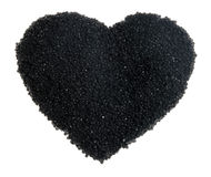 Black caviar in the form of heart Stock Image