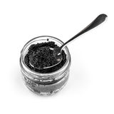 Black caviar in a glass jar with teaspoon Royalty Free Stock Photos
