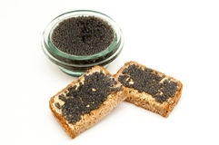 Black caviar in a jar and bread Stock Photos