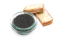 Black caviar in a jar and bread Royalty Free Stock Image