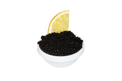Black caviar and lemon Stock Images