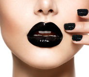 Black Caviar Manicure and Black Lips Royalty Free Stock Images