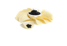 Black caviar and potato chip Royalty Free Stock Photos