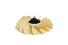 Black caviar and potato chip Royalty Free Stock Photography