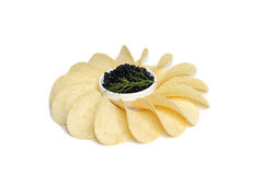 Black caviar  and potato chip Stock Photos
