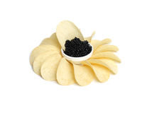 Black caviar and  potato chips Royalty Free Stock Photography