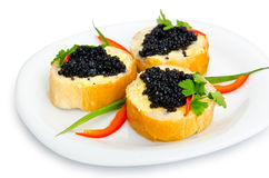 Black caviar served on bread Royalty Free Stock Image