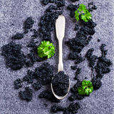 Black caviar in the spoon royalty free stock images