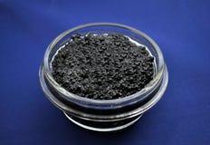 Black caviar - symbol of wealth Royalty Free Stock Photos