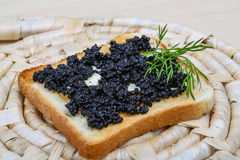 Black caviar toast Stock Photos