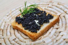 Black caviar toast Royalty Free Stock Images