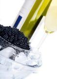 Black caviar with wine. Black caviar - symbol of wealth Stock Photos