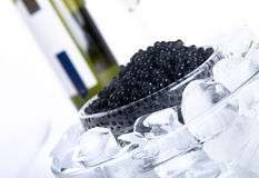 Black caviar with wine. Close up Royalty Free Stock Image