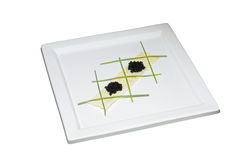 Black Caviar With Potato Crisp And Onion Shoots Royalty Free Stock Images