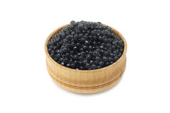 Black caviar in a wooden bowl Stock Photography