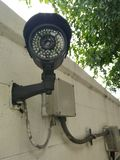Black CCTV camera. Mounted outdoors Royalty Free Stock Photography