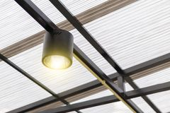 A black ceiling light with warn light royalty free stock photo