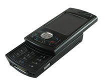 Black cell phone. A black slideout cell phone on white Royalty Free Stock Photo