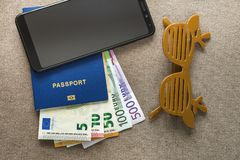Free Black Cellphone, Money Euro Banknotes Bills, Passport And Toy Funny Sunglasses On Copy Space Background, Top View. Traveling, Stock Image - 154405371