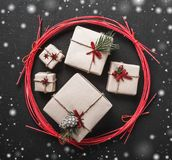 Black cement background, for winter holidays, handmade gifts in a red circle, snowflake effect. Top view Royalty Free Stock Images