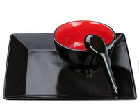 Black ceramic bowl and spoon on tray isolated on white backgroun Stock Photo