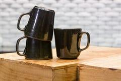 Black ceramic coffee cups Royalty Free Stock Photos