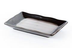 Black ceramic plate Royalty Free Stock Photos