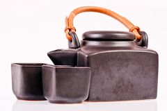 Black ceramic teapot on white Stock Photo