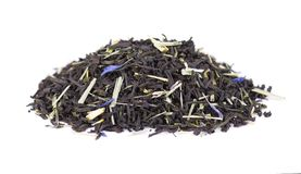Black Ceylon tea with lemongrass and cornflower petals isolated on a white background. Black Ceylon tea with bergamot, isolated on white background. Top view stock photos