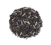 Black Ceylon tea with lemongrass and cornflower petals isolated on a white background. Top view. royalty free stock photography