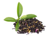 Black ceylon tea with rose petals, cornflowers and sunflower, isolated on white background. Black ceylon tea with rose petals, cornflowers and sunflower royalty free stock image