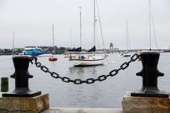 Black Chain on Bollards with Boston Harbor in Backgrounds Royalty Free Stock Photos
