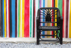 Black chair and colorful wall Stock Photo