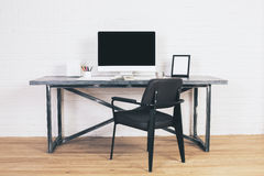 Black chair at desk Stock Photo