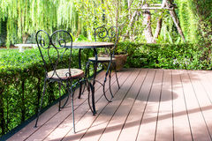 Black chair in the garden for relax. Stock Images