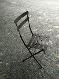 Black chair on the ground Royalty Free Stock Image