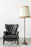 Black chair with lamp Royalty Free Stock Photography