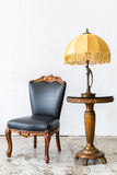 Black chair with lamp Stock Photography