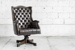 Black Chair in vintage room Royalty Free Stock Photo