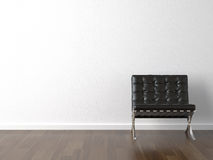 Black chair on white wall Stock Photo