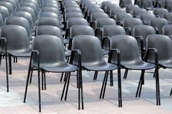 Black chairs. Rows of black plastic chairs Royalty Free Stock Photo
