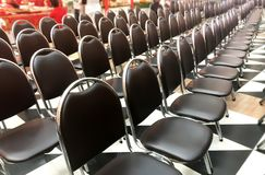 Black Chairs Line Up in Row. Side View of Black Chairs Line up in Row, no people Royalty Free Stock Images