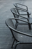 Black chairs in a outdoor cafe. Image of black chairs in a outdoor cafe Royalty Free Stock Photography